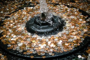 Why Do We Throw Coins into Fountains?